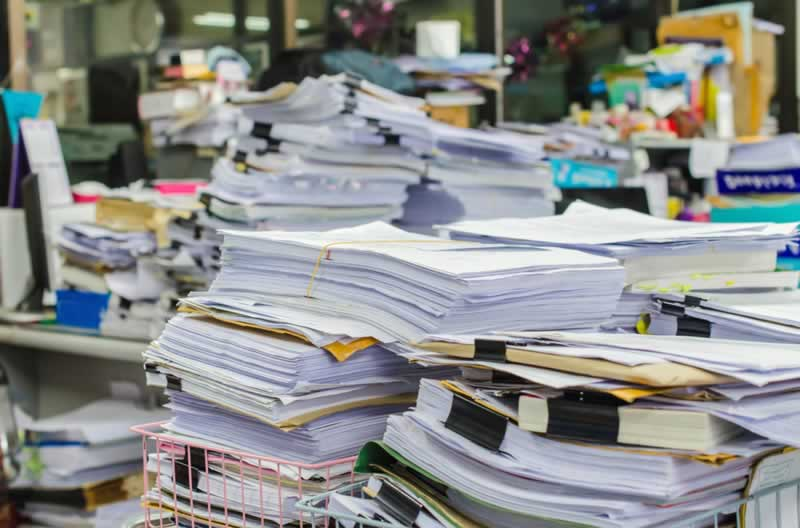 Top Tips To Minimize The Paper Waste At Your Workplace - papers