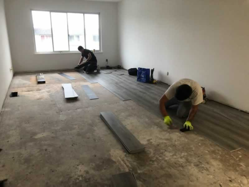 10 Tips for Keeping Neighbors Happy During Renovation - laying floor