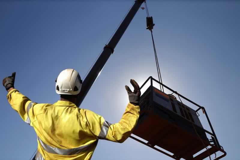 Essential Hand Signals for Crane Operators - lowering