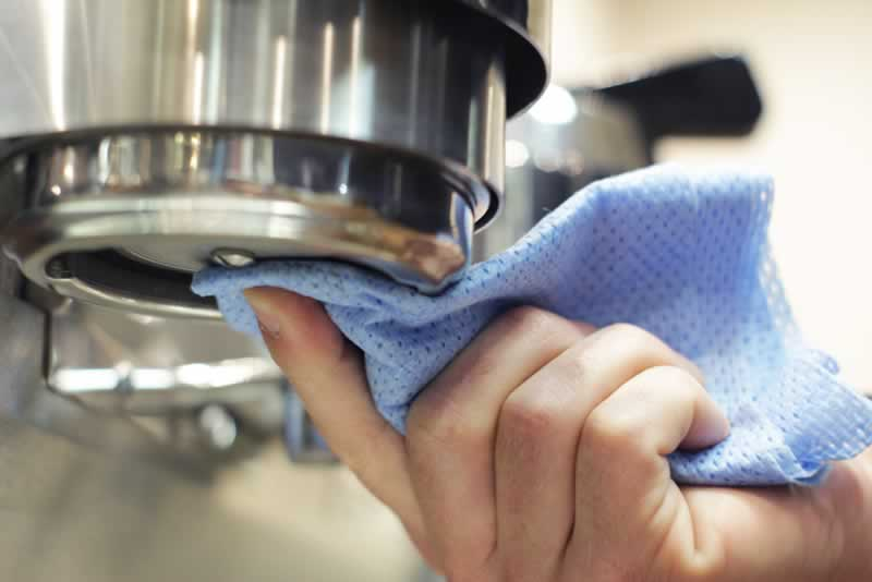 How to Properly Maintain and Clean Coffee Machines - wiping