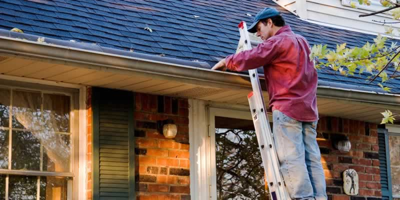 Spring Home Maintenance Checklist - cleaning gutters