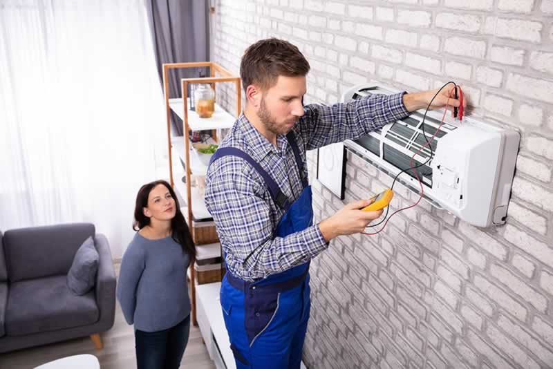 Huntley Illinois Home Repair Tips - Making Your AC More Efficient with Repairs - technician