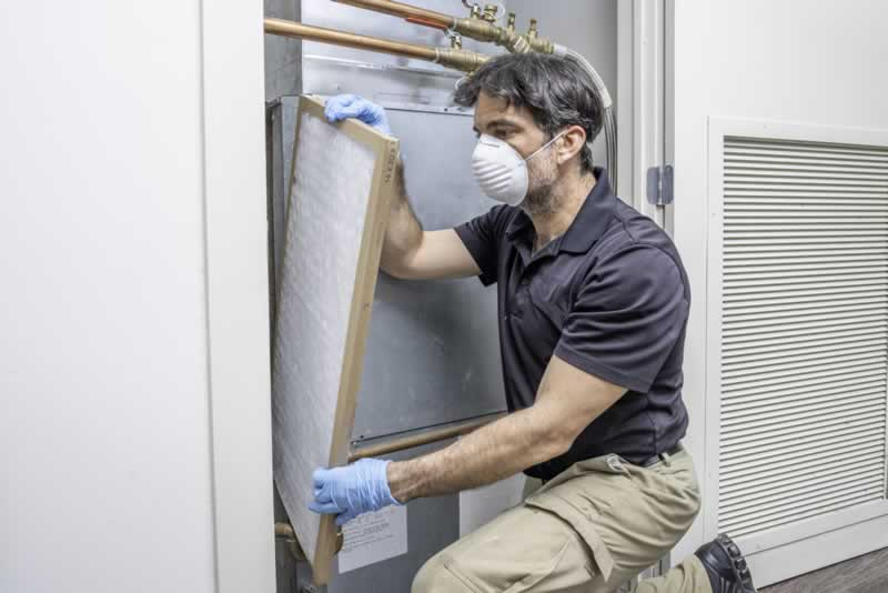 What To Look For When Hiring An HVAC Contractor - changing filter