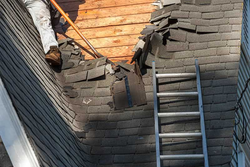 5 Steps for Removing a Roof - removing shingles