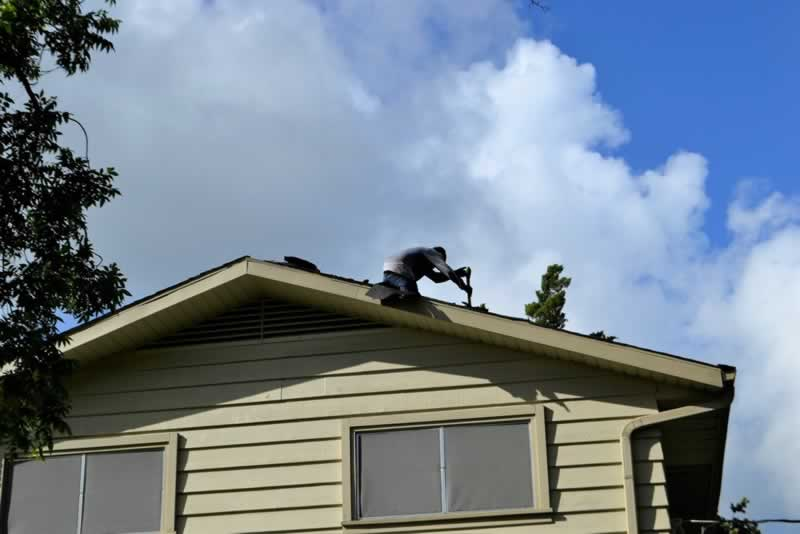 Helpful Tips To Keep Your Home Safe From Floods - inspecting roof