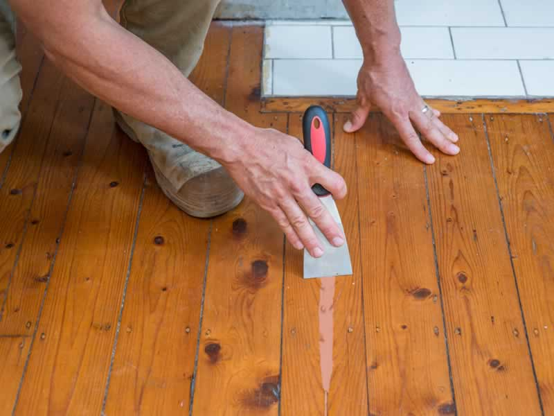 How to Fill the Gaps in Your Home's Wood Floors - filler
