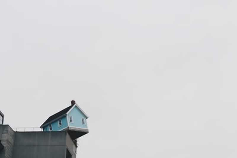 The Importance of Home Insurance - house on edge