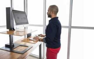 Why Businesses Should Embrace Standing Desks - working