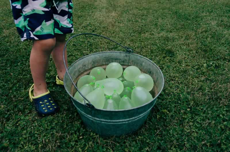 4 Useful Tips To Enjoy The Outdoors With Your Family - water baloon