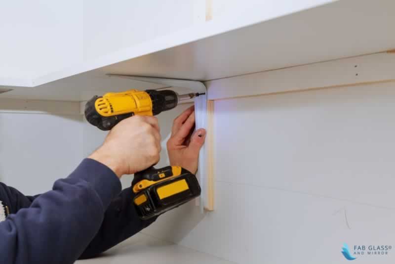 DIY Crafts to Install Glass Shelves for Glamorous Home Décor - drilling the wall
