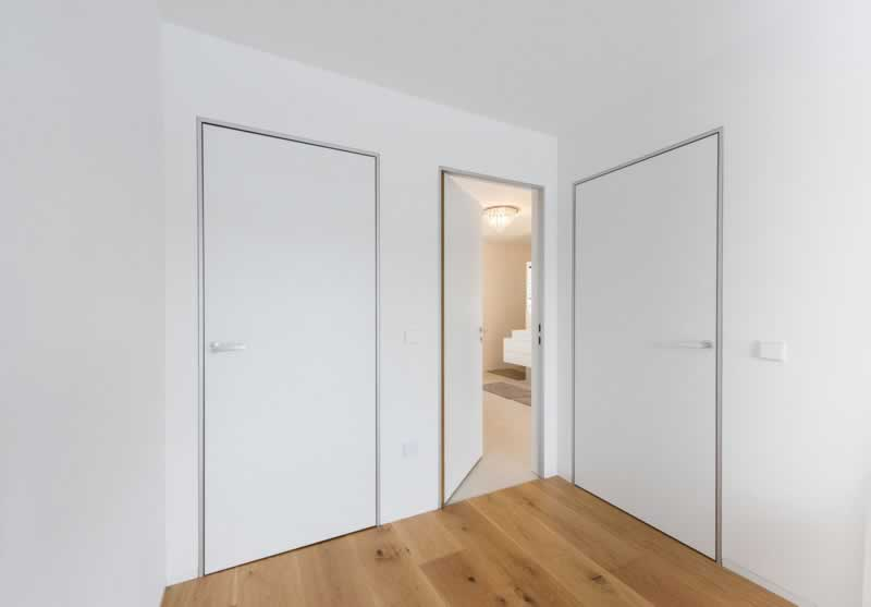 Everything to know about a flush wall door - doors