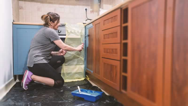 Easy DIY Home Improvement Projects to Try Next - painting cabinets