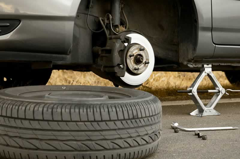 6 Car Repairs Every Car Owner Should Know How to Do - changing flat tire
