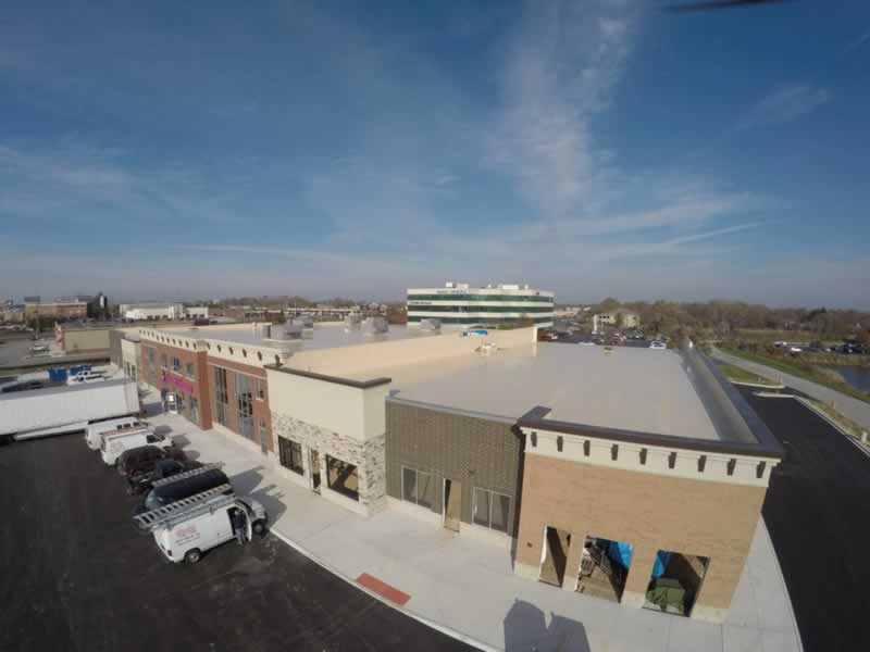 Top 5 Benefits of Flat Roof Installation for Your Business